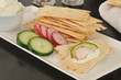 Flatbread crackers with cream cheese and vegetables