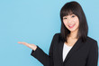 asian businesswoman showing on blue background