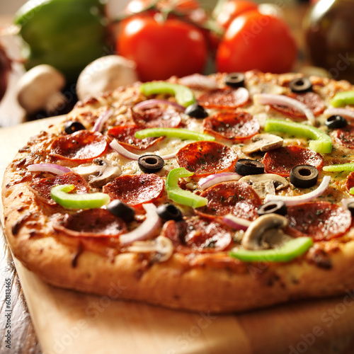 supreme italian pizza with pepperoni and toppings Poster