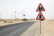 Arabian people crossing the road sign in Qatar, Middle East