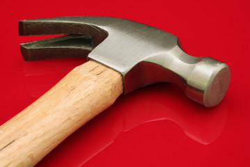 Hammer On A Red Background