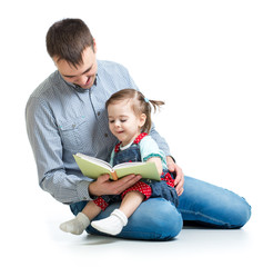 father reading a book to kid