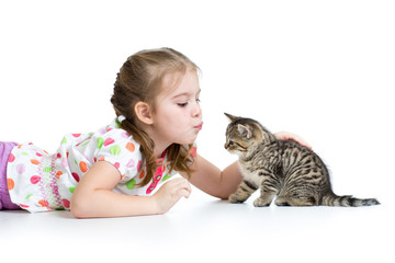 cute kid playing and kissing Scottish kitten