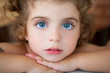big blue eyes toddler girl looking at camera