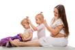 The pregnant woman and girls braid hair