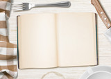 kitchen table with open book or copybook as a background for coo