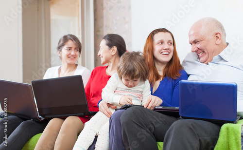 Happy family enjoys with few laptops