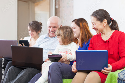 family of three generations   with laptops