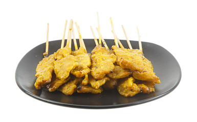 Pork satay on dish isolated on white