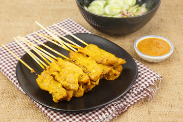 Pork satay on dish with peanut  sauce