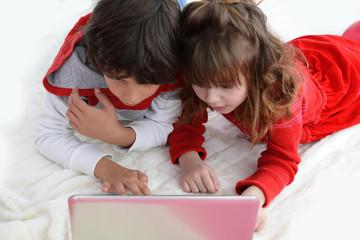 Boy and girl watching laptop screen