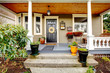 Pretty column porch with wooden ceiling