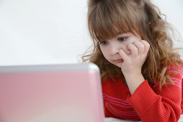 Girl in red watching laptop screen