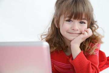 Girl in red watching laptop screen smiling