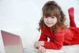 Girl in red watching laptop screen