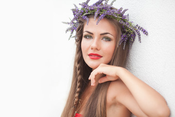 Portrait of young woman in lavender wreath. Fashion, Beauty.