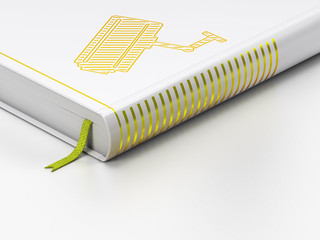 Protection concept: closed book, Cctv Camera on white background