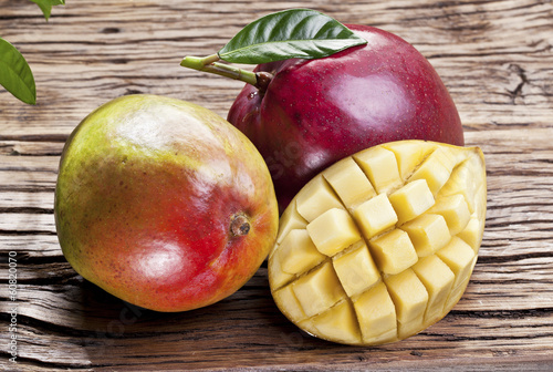 Mango fruits on a wooden table.
