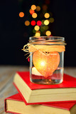 Romantic background, heart candle and bokeh lights.