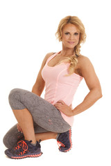 Mature woman one knee fitness pink tank