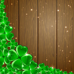 Clover background on wooden surface