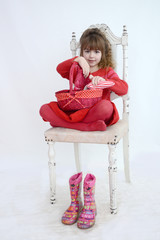 Girl holding red picnic basket