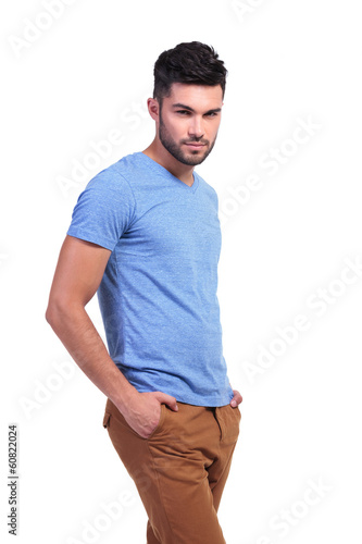 smiling casual man with hands in pockets