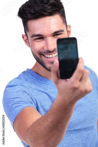 man taking his own picture with his smart phone