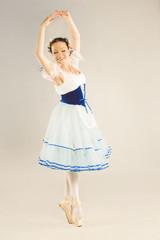 Ballerina dancing in studio.