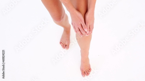 Woman touching her sore knee