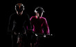 low key silhouette of a man and a girl cyclists - 60824478
