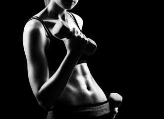 Closeup photo of a fitness model body on black background