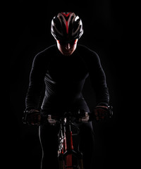 low key silhouette of a male cyclist