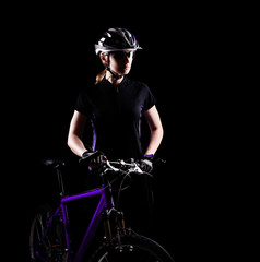 Low key silhouette of a girl cyclist