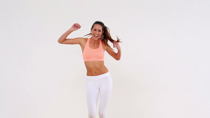 Fit pretty model dancing and smiling at camera