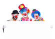 Three smiling clowns holding the blank board on white background