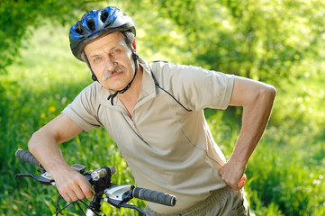 Senior active cyclist in the park