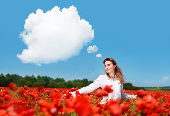 walking in a poppy field looking to the clouds