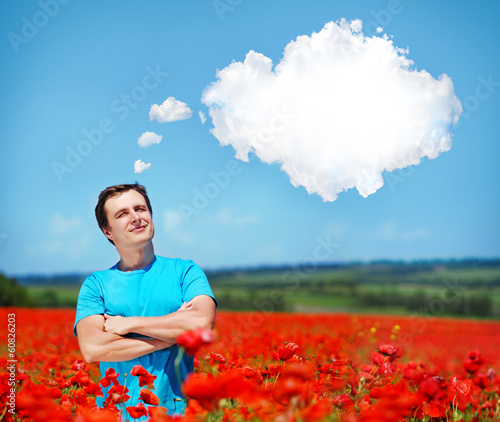 man  in the poppy field  looking to the  thinking clouds bubble