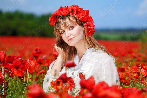 Beautiful girl wearing poppy headband
