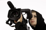 An Arab Student Using A Cinema Camera In A Filming Studio