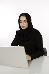 An Arab Student Working On Her Laptop