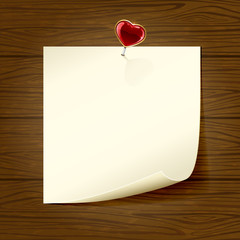 Paper and heart on wooden background
