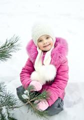 Outdoor portrait of beautiful little girl
