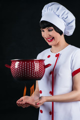 chef prepares soup pot levitating