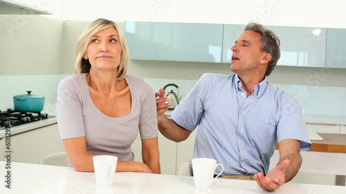 Couple having an argument over coffee