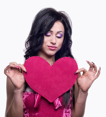 Heart in the hands of the model