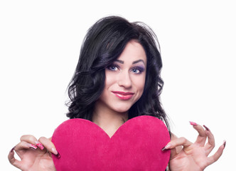 Girl holding a pink heart