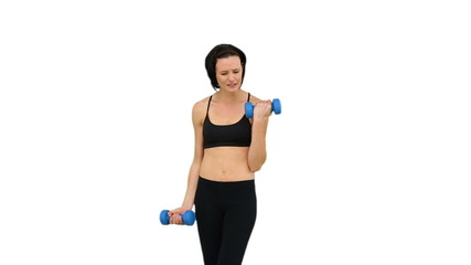 Fit brunette lifting dumbbells