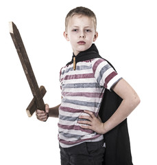 Brave little boy with wooden sword